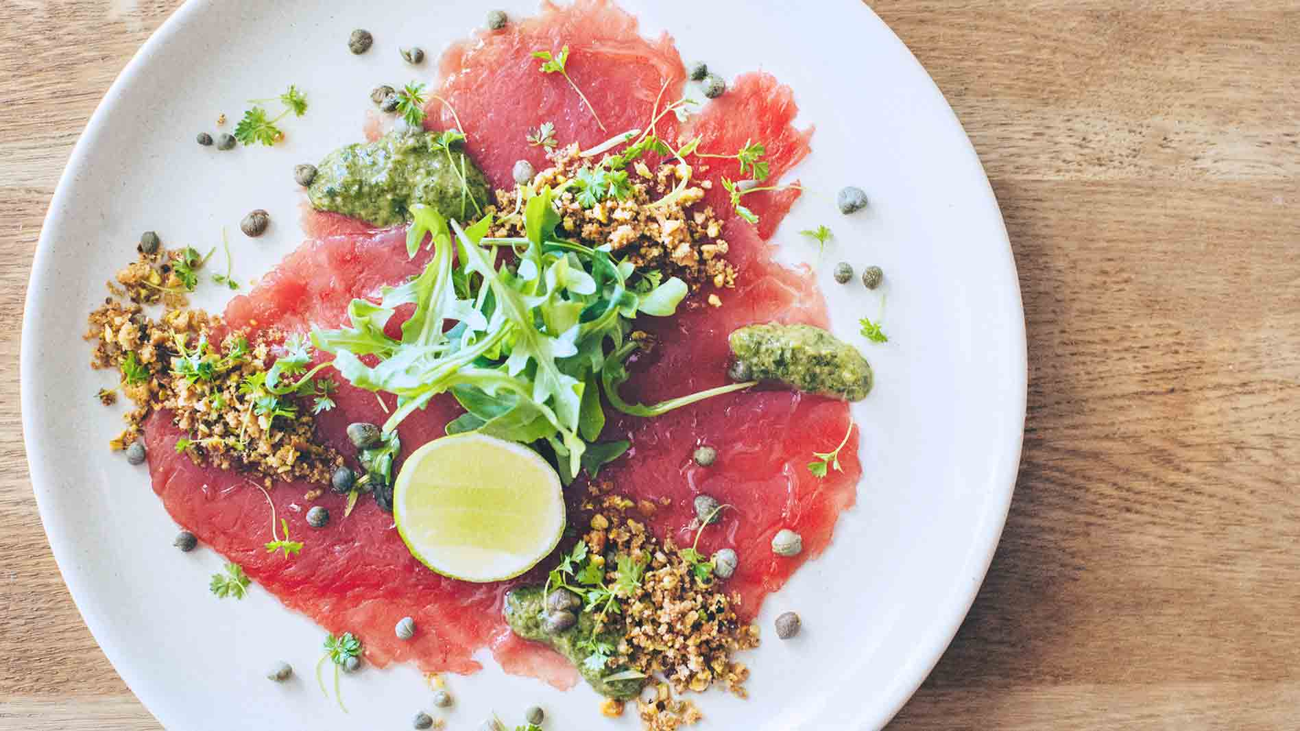 Tuna Carpaccio with Pistachio and Olive Crumble