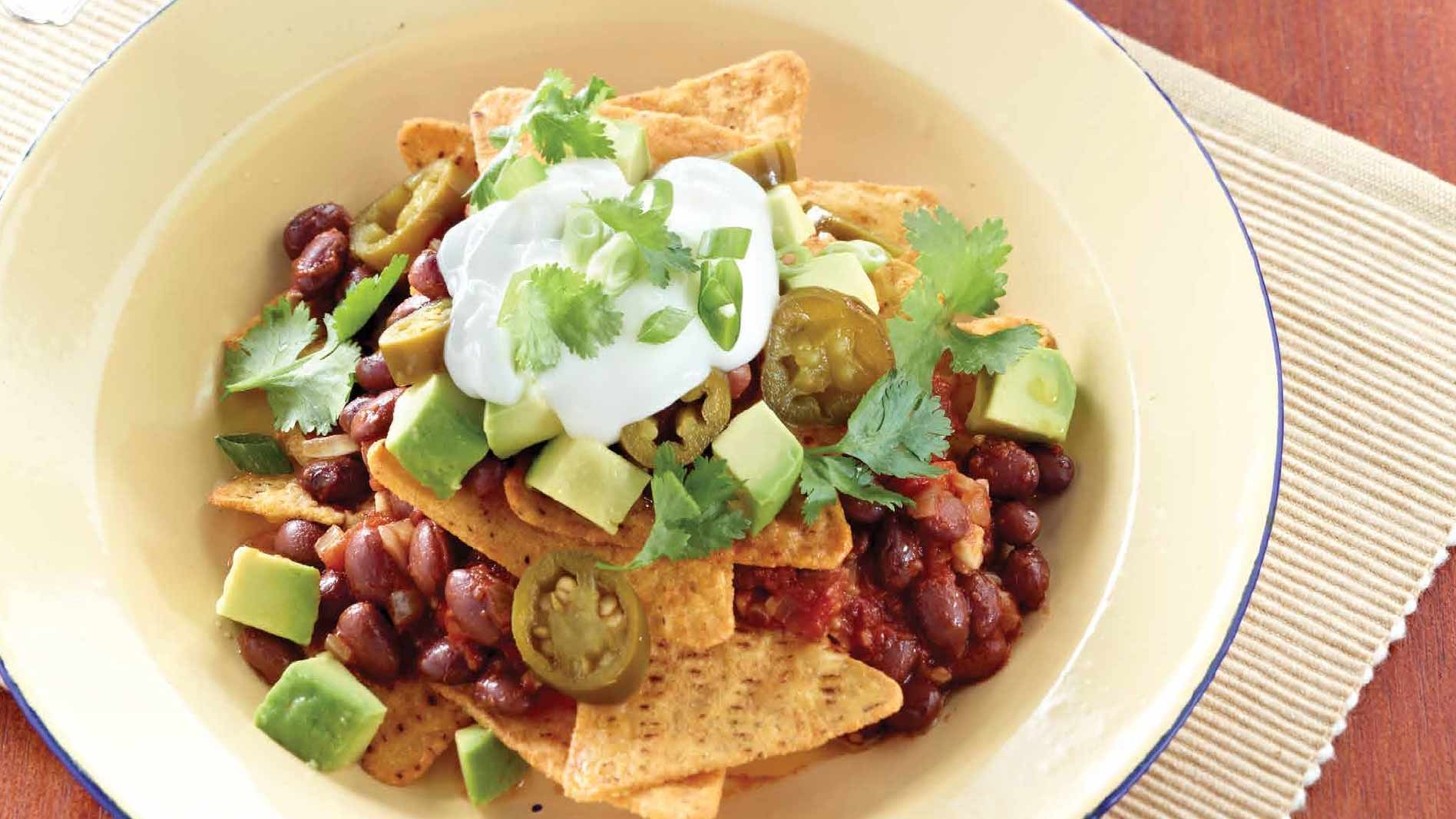 Spicy Vegetarian Nachos with Avocado, Jalapenos and Beans