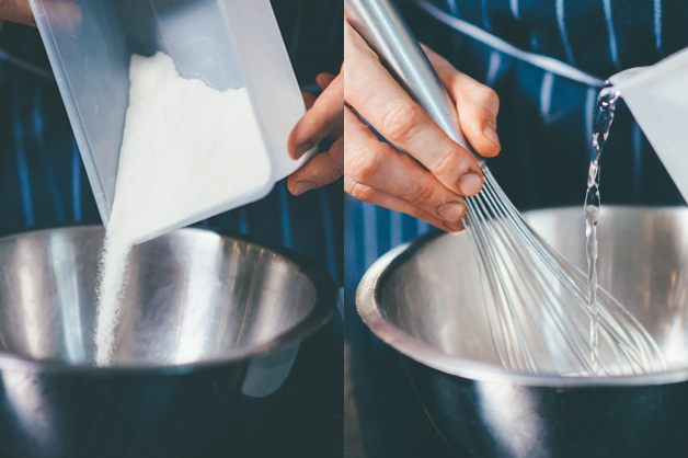Pouring custard mixture and water into the bowl