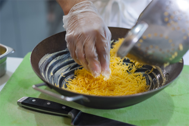 Cooked rice being dished into a bowl
