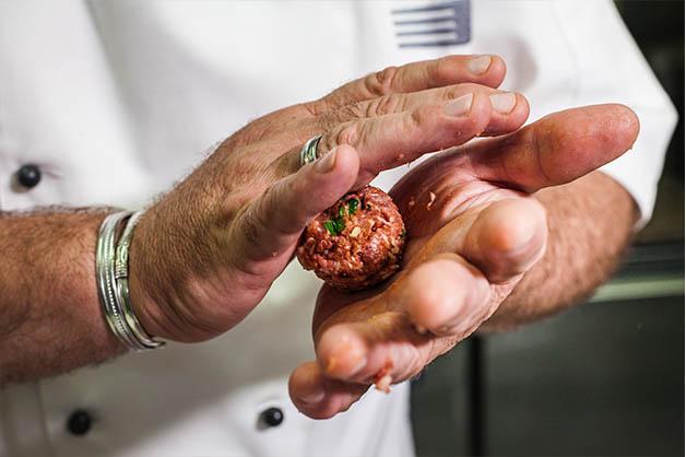 Rolling of meatballs