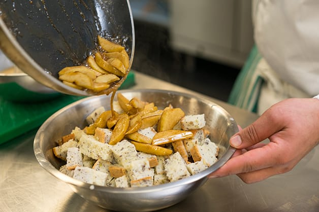 Adding the cooked apples to the bread