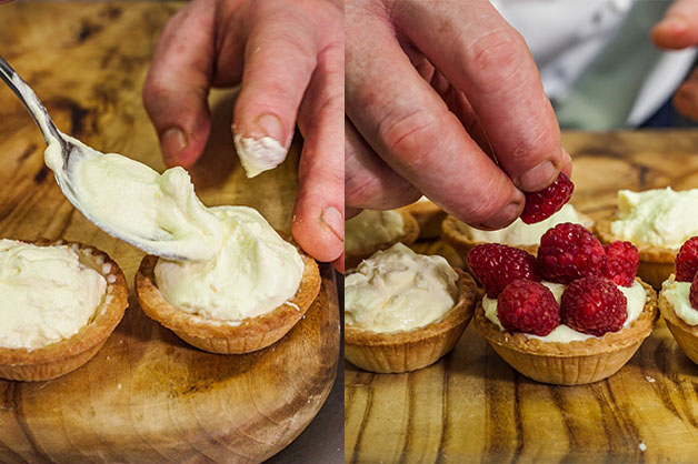 Filling the tartlet and placing raspberries on top