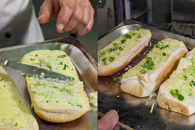 Spread being placed on garlic bread
