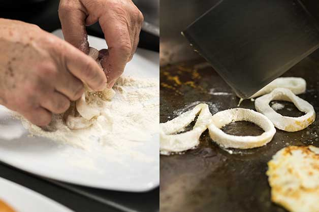 Chef coating the calamari in flour then grilling them