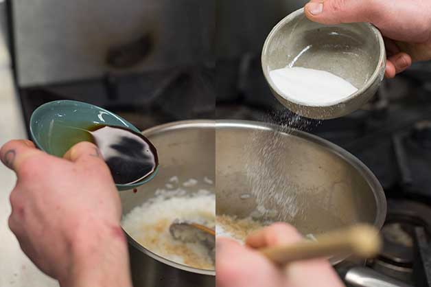 Chef adding ingredients to the boiling rice