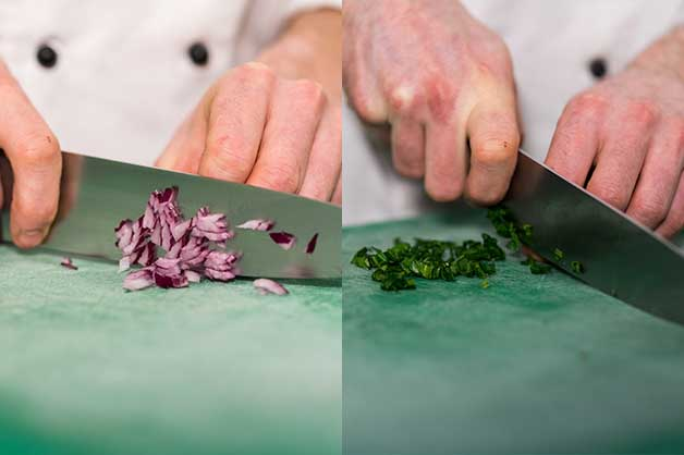 Image of the chef slicing the onion and spinach