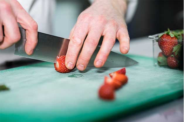 Chef slicing the strawberries