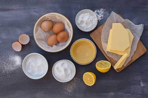 The photo shows all of the ingredients for the lemon curd tartlets