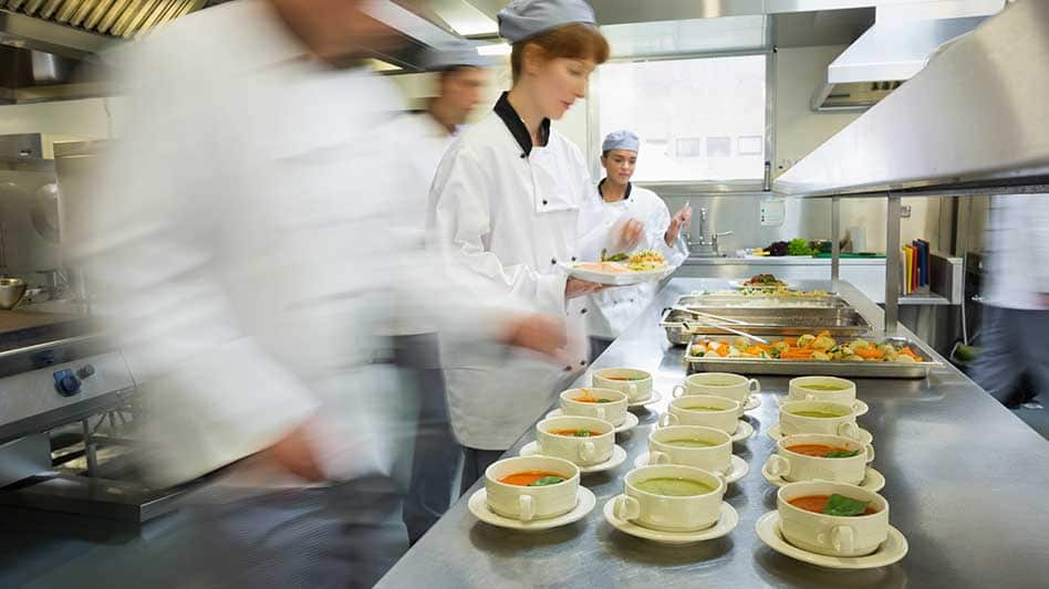 A photo showing chefs working in the kitchen