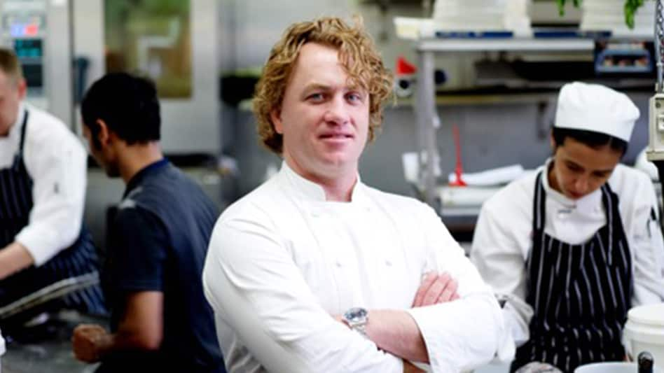 A photo that shows Adrian Richardson standing in the kitchen