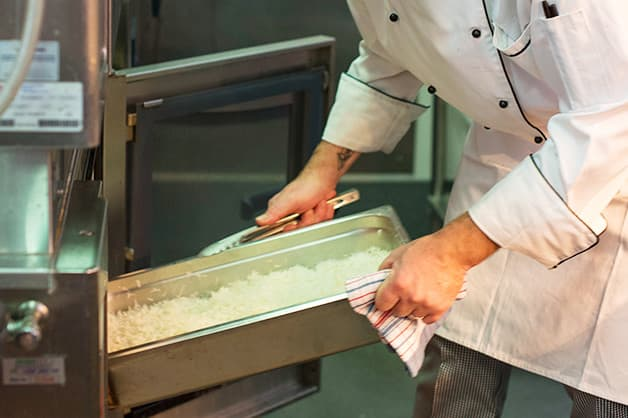 In this photo the chef is seen placing the rice in the oven