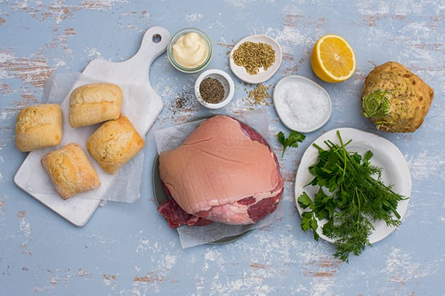 Image shows all of the raw ingredients used in the pulled pork rolls recipe