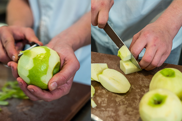 The picture shows the chef peeling and cutting the apples