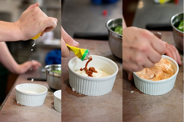 The chef is seen combining ingredients for the mayonnaise sauce