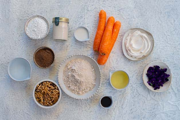 This image shows the raw ingredients for vegan carrot cake recipe