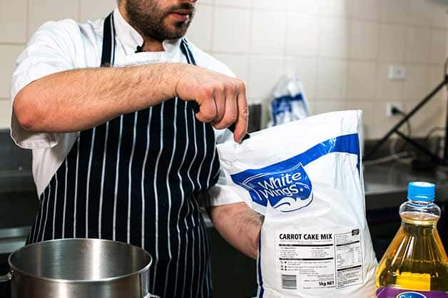 Image shows the chef using the White Wings Carrot Cake Mix