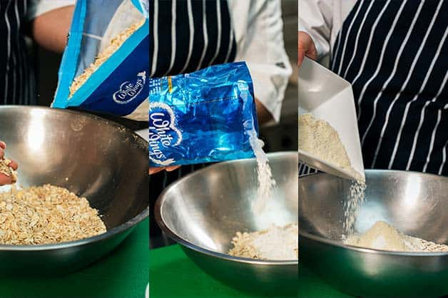 The chef is seen creating the crumble with White Wings Rolled Oats