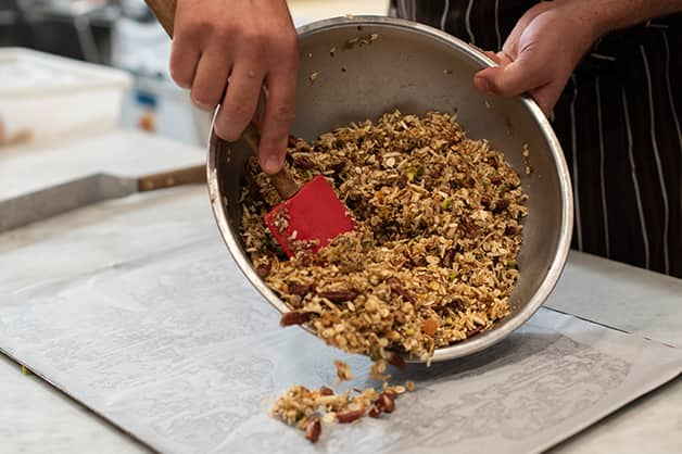 Laying the White Wings Muesli mixture on a tray