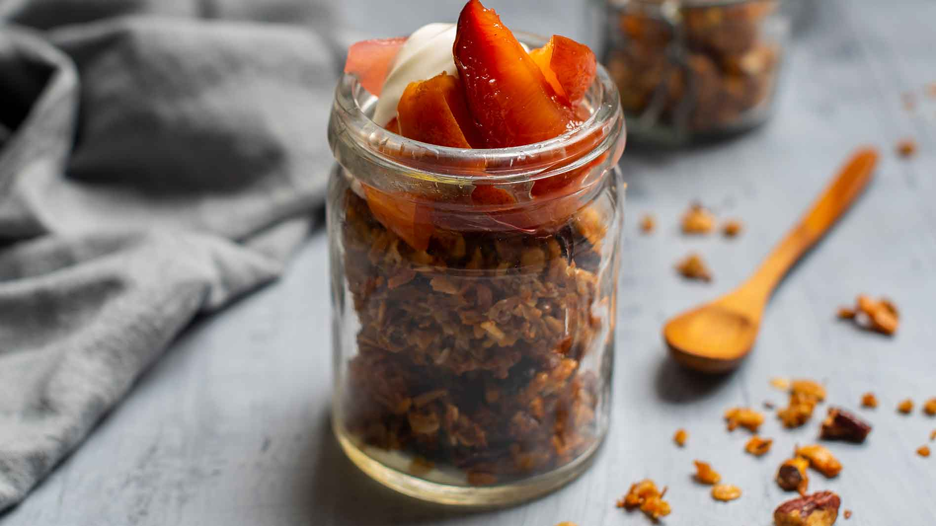 Homemade granola with honey and poached fruits