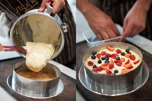 Adding the mix to the pan and topping with berries