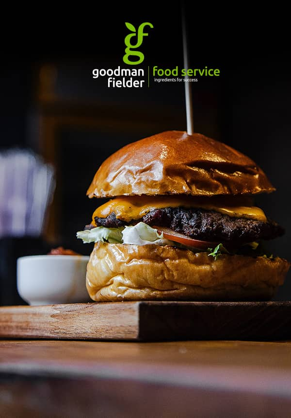 Poster of gourmet burger on a breadboard