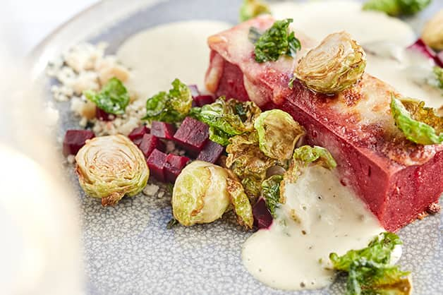 Baked beetroot roman gnocchi, smoked scamorza, brussels sprout crisps, marjoram, macadamia crumble, burnt butter cream V