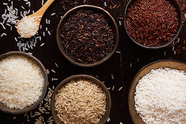 The photo is of five different types of rice