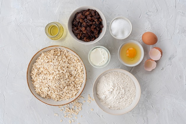 Raw ingredients for the oat and sultana muffins are shown in this image