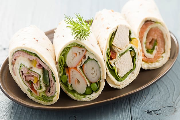 Photo shows four wraps, each with different fillings