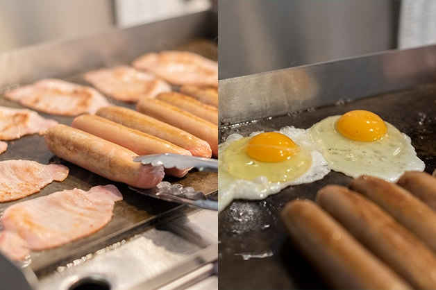 Photo shows the chef frying the sausages, bacon and eggs