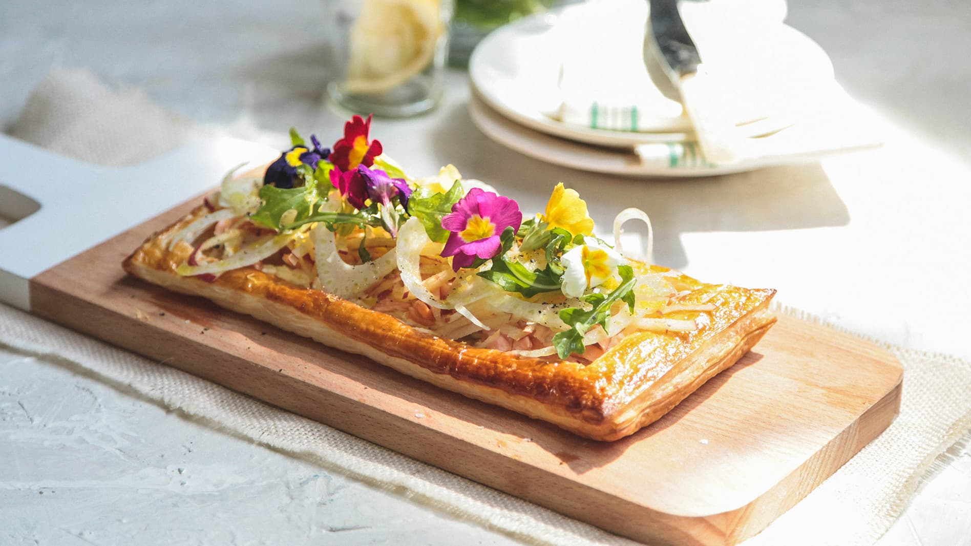 Smoked trout labneh tart with fennel, apple and rocket