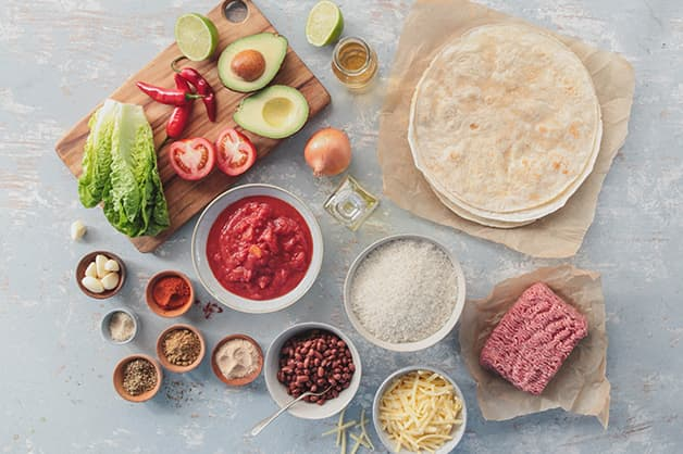 Raw ingredients for the burrito recipe are pictured