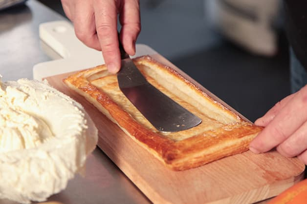 The chef is seen pushing down the Pampas Puff Pastry