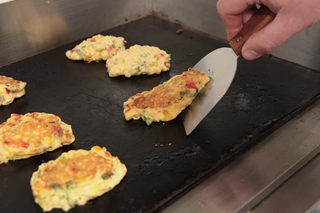Image of the chef frying the corn fritters