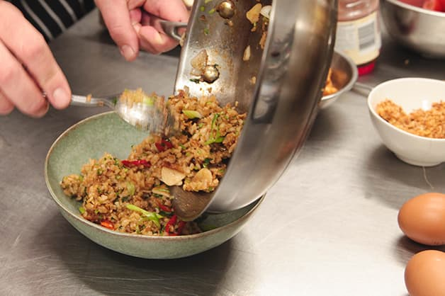 Chef is seen Pouring the mixture into the plate