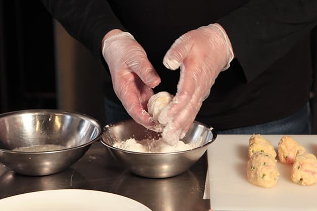 Chef coats the croquettes with White Wings Plain Flour