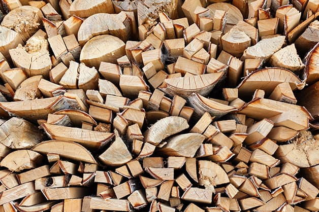 Image shows a pile of wood