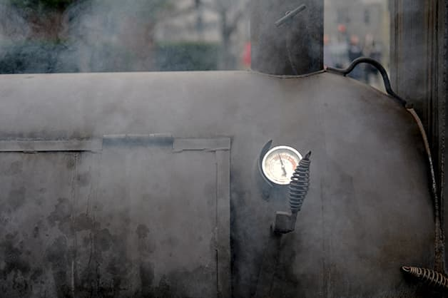 Image is of a smoking machine for food