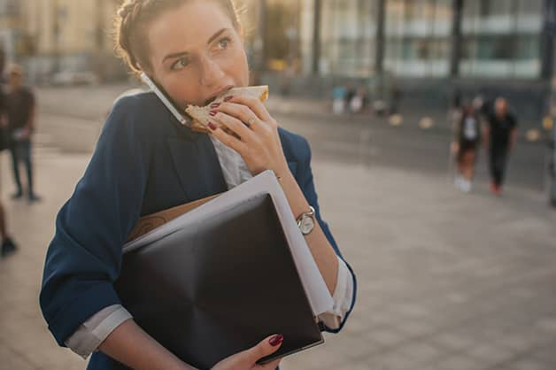 Image of female eating on the go