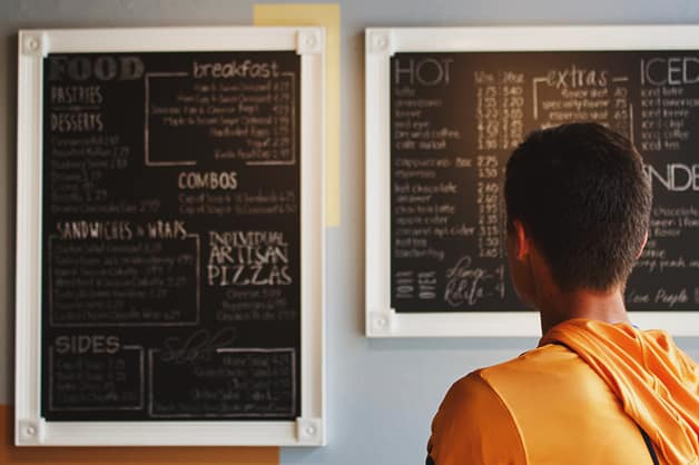 Person looking at a blackboard menu