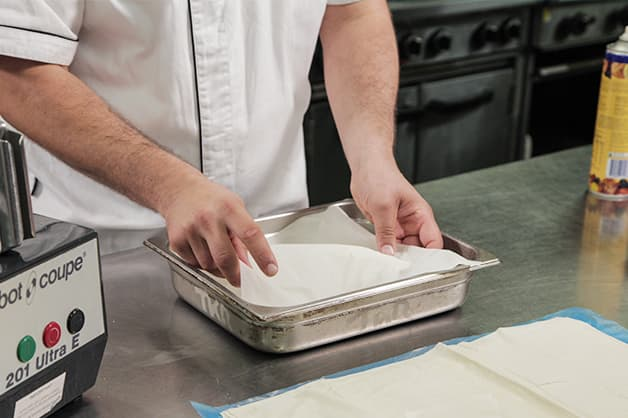 Lining a baking tray with Pampas Filo Pastry