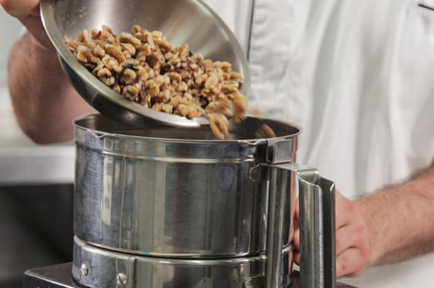 Placing nuts in a food processor