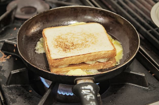 Frying the filled sandwich with butter on the stove