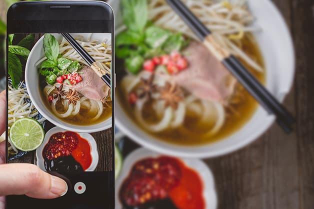 Image of a person taking a photo of food