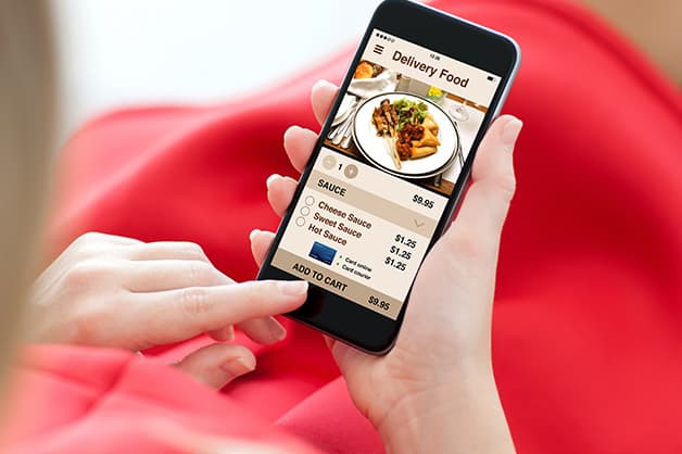 Person is pictured ordering food on their phone