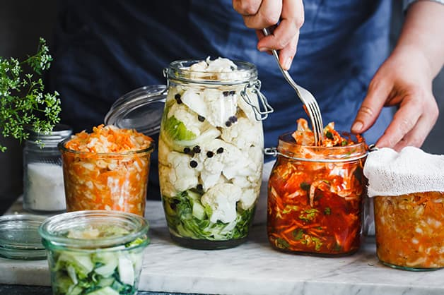 Image of four jars filled with fermented goods