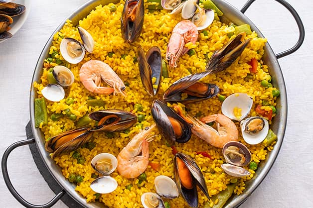 Image is of a dish of paella