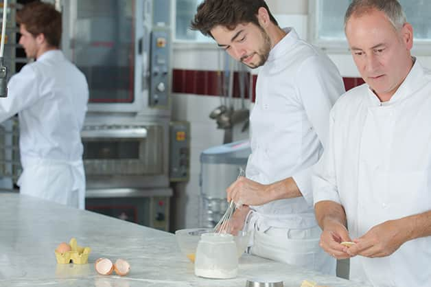 Mentoring between two chefs in the kitchen