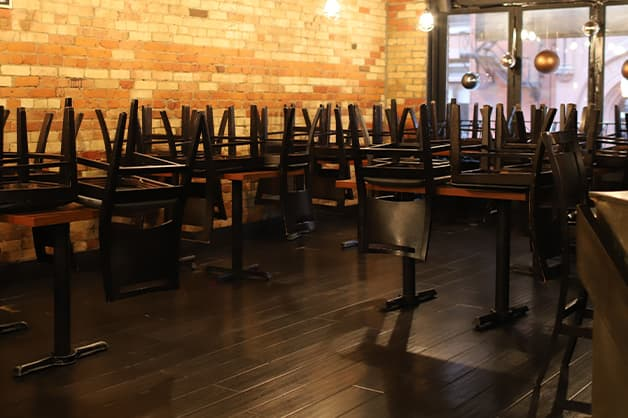 Chairs stacked in an empty restaurant